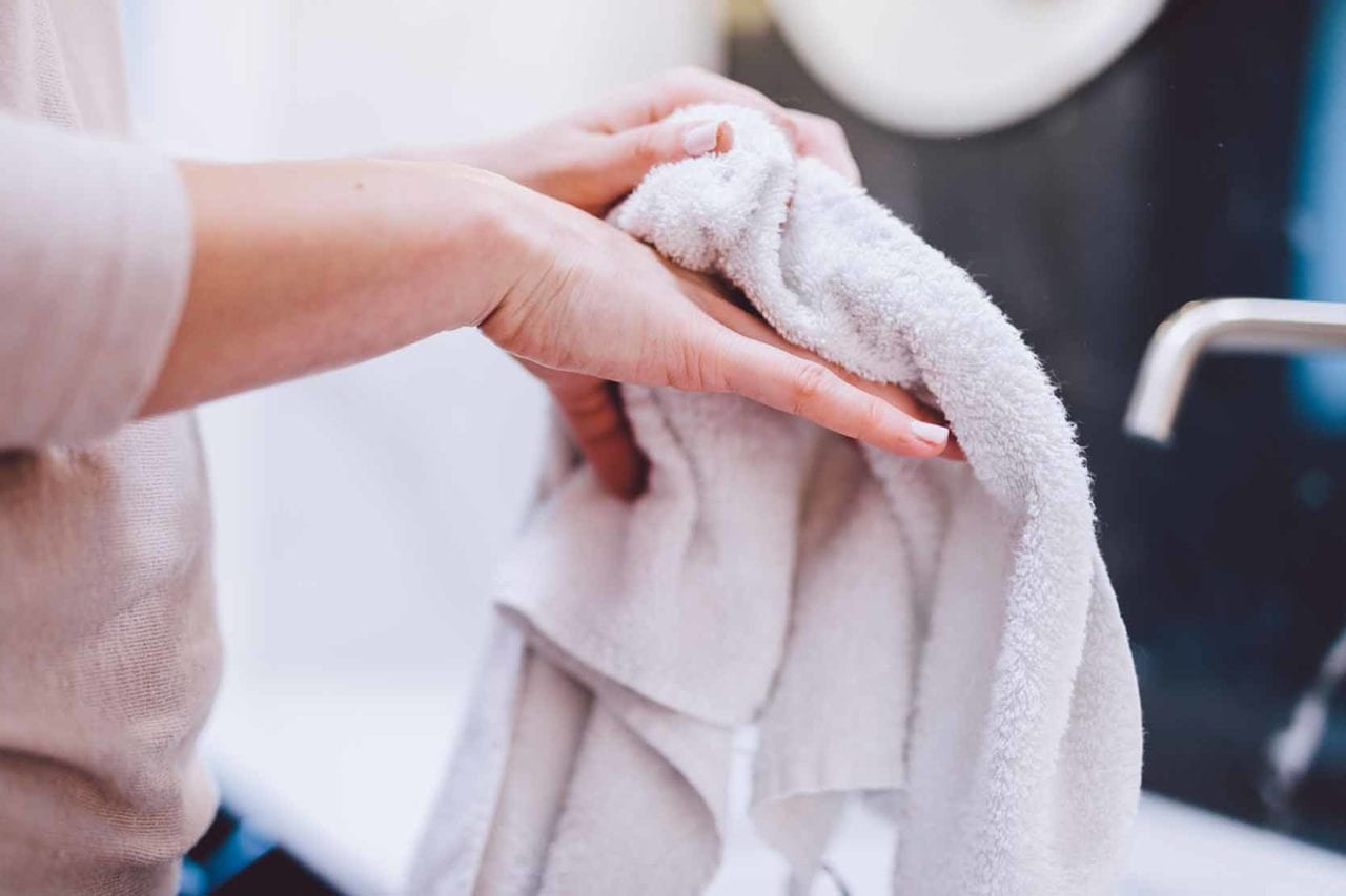 Woman wiping hands on towel